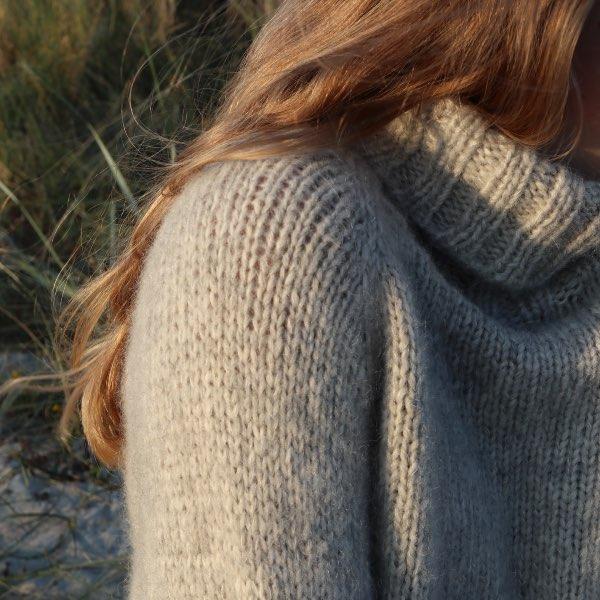Skulderen på Cinis Sweater